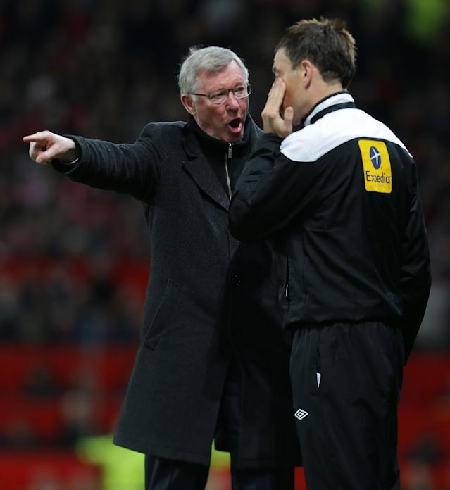 MANCHESTER, ENGLAND - APRIL 22: Manager Sir Alex Ferguson of Manchester United complains to fourth official Mark Clattenburg the Barclays Premier League match between Manchester United and Aston Villa at Old Trafford on April 22, 2013 in Manchester, England. (Photo by Tom Purslow/Man Utd via Getty Images)