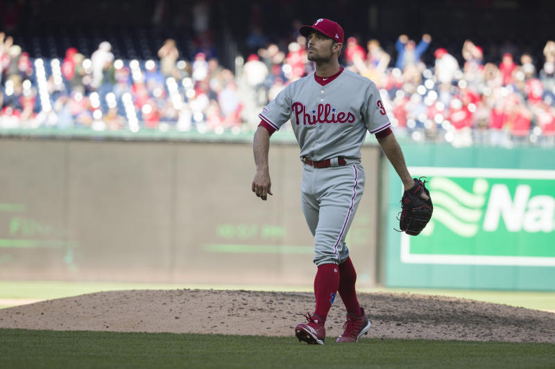 Philadelphia Phillies relief pitcher David Robertson walks off the field after walking in the winning run after a baseball game against the Washington Nationals at Nationals Park, Wednesday, April 3, 2019, in Washington. The Nationals won 9-8. (AP Photo/Alex Brandon)