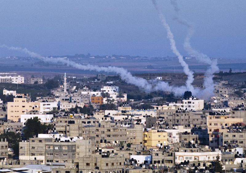 Smoke trails mark the path of Palestinian missiles fired from the north-east of Gaza City on August 21, 2014