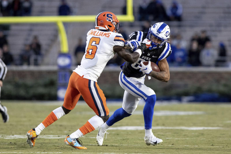 Duke's Aaron Young (81) carries the ball as Syracuse's Trill Williams (6) attempts a tackle during the first half of an NCAA college football game in Durham, N.C., Saturday, Nov. 16, 2019. (AP Photo/Ben McKeown)