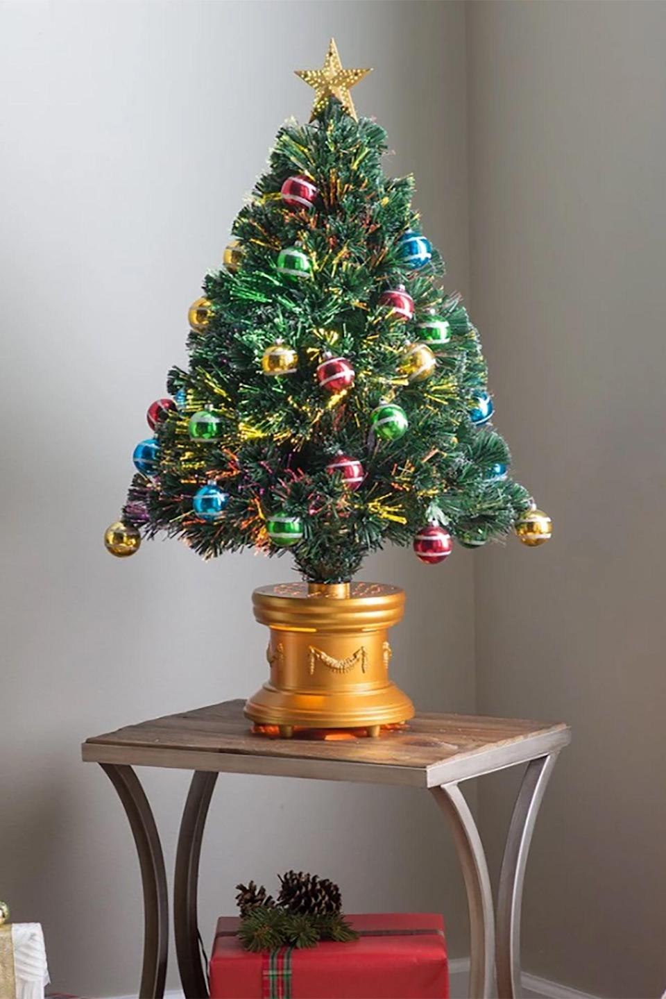"""<p><strong>National Tree Company</strong></p><p>homedepot.com</p><p><strong>$90.63</strong></p><p><a href=""""https://go.redirectingat.com?id=74968X1596630&url=http%3A%2F%2Fwww.homedepot.com%2Fp%2FNational-Tree-Company-36-in-Fiber-Optic-Fireworks-Tree-with-Ball-Ornaments-SZOX7-100L-36-1%2F300496224&sref=https%3A%2F%2Fwww.countryliving.com%2Fhome-design%2Fdecorating-ideas%2Fg5027%2Fbest-artificial-christmas-trees%2F"""" rel=""""nofollow noopener"""" target=""""_blank"""" data-ylk=""""slk:Shop Now"""" class=""""link rapid-noclick-resp"""">Shop Now</a></p><p>This dazzling tabletop piece is already outfitted with ornaments, meaning less time decorating and more time enjoying <a href=""""https://www.countryliving.com/food-drinks/g647/holiday-cookies-1208/"""" rel=""""nofollow noopener"""" target=""""_blank"""" data-ylk=""""slk:Christmas cookies"""" class=""""link rapid-noclick-resp"""">Christmas cookies</a>.</p>"""