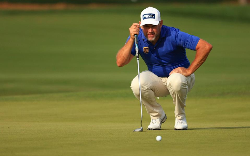 Lee Westwood of England lines up a putt - Mike Ehrmann/Getty Images