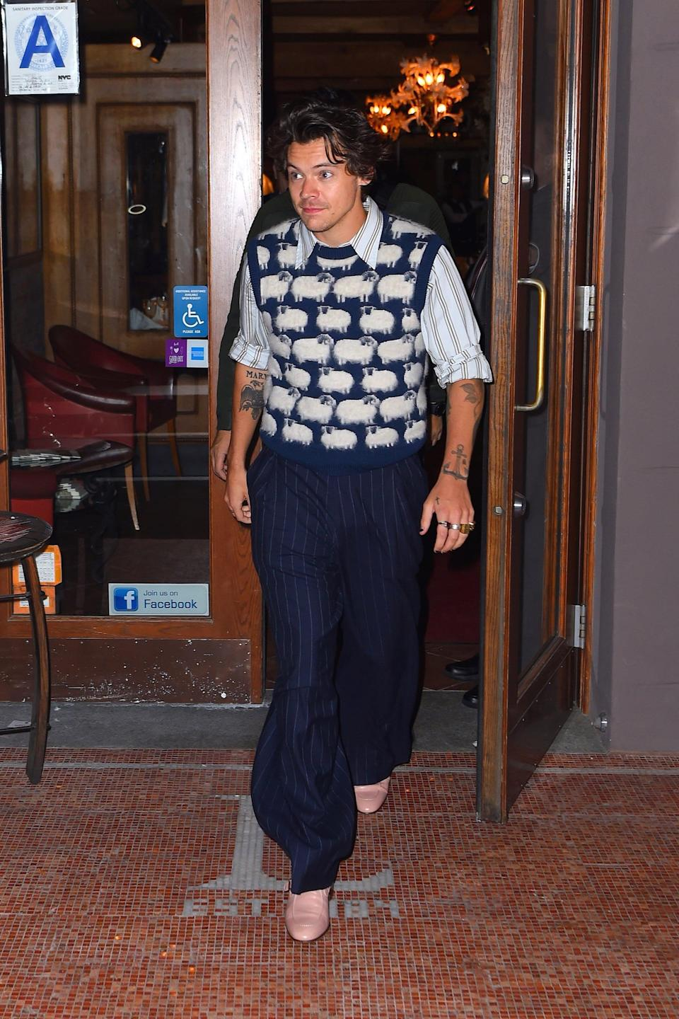 """<p>The internet essentially shattered into a zillion pieces when Harry stepped out in <a href=""""https://www.popsugar.com/fashion/harry-styles-sheep-print-sweater-vest-46900381"""" class=""""link rapid-noclick-resp"""" rel=""""nofollow noopener"""" target=""""_blank"""" data-ylk=""""slk:this endearing sheep print sweater vest by Lanvin"""">this endearing sheep print sweater vest by Lanvin</a> in November 2019. Fans instantly drew comparisons to a similarly printed sweater Princess Diana wore back in the day, and Harry chose to style his with a striped shirt, navy pants, and light-pink boots. What. A. Look.</p>"""