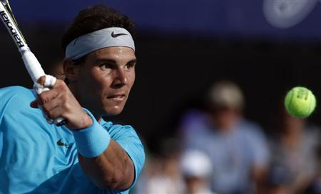Rafael Nadal of Spain plays a shot during his exhibition tennis match against Novak Djokovic of Serbia in Buenos Aires