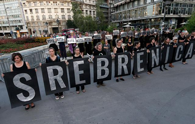 "<p>Members of anti-war organization ""Women in Black"", hold banners that read: ""SREBRENICA"" as part of a meeting to mark the 22th anniversary of the Srebrenica tragedy when in 1995 Bosnian Serb forces stormed the enclave and systematically killed thousands of Bosnian Muslims, in downtown Belgrade, Serbia, Monday, July 10, 2017. (Photo: Darko Vojinovic/AP) </p>"