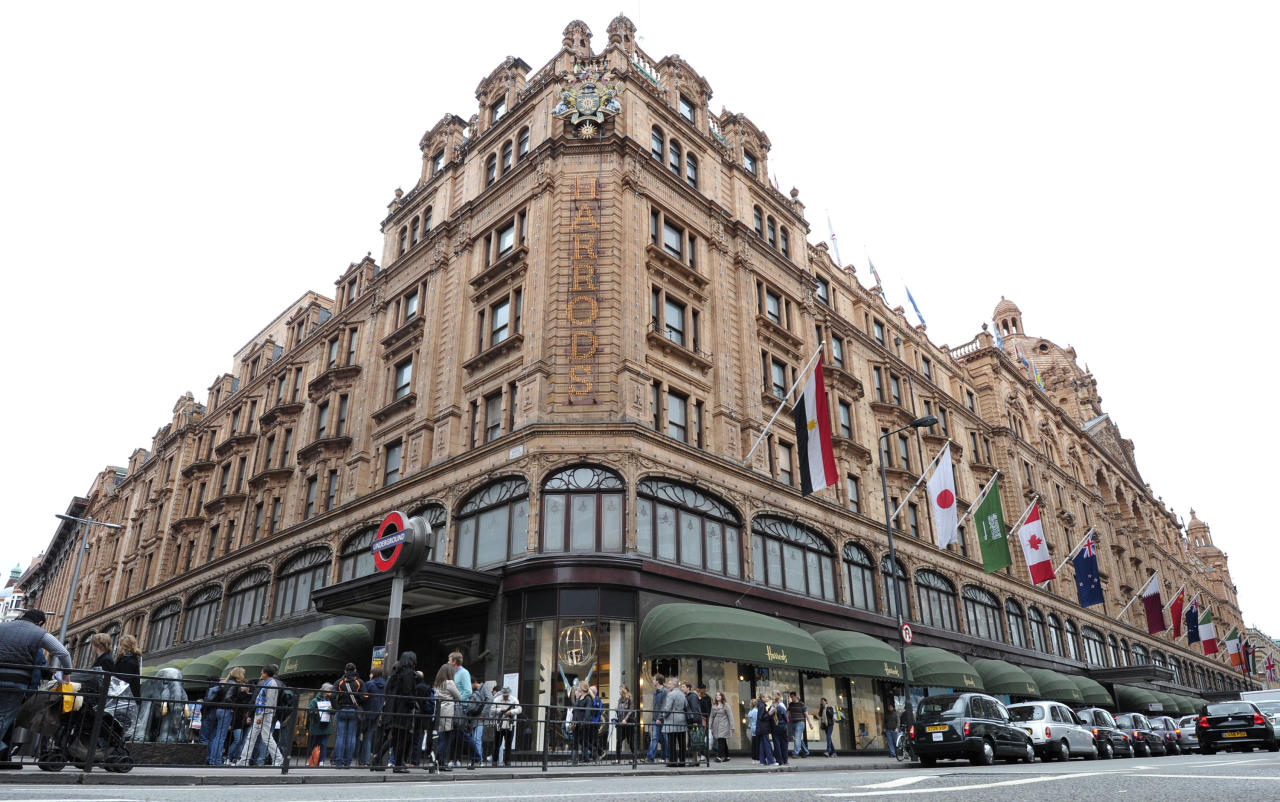 People walk in front of the Harrods department store in London, on May 8, 2010. Egyptian billionaire Mohamed Al Fayed has sold luxury London department store Harrods to the investment arm of Qatar's sovereign wealth fund, his financial advisors Lazard said on May 8, 2010. AFP PHOTO CARL COURT