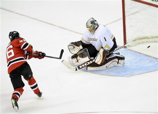New Jersey Devils' Patrik Elias, left, of the Czech Republic, scores a goal against Anaheim Ducks goaltender Jonas Hiller, of Switzerland, during a shootout in an NHL hockey game Friday, Feb. 17, 2012, in Newark, N.J. The Devils defeated the Ducks 3-2. (AP Photo/Bill Kostroun)