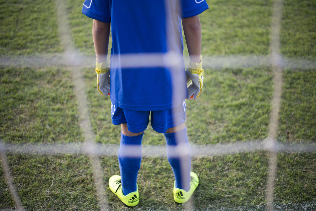 <p> In this Thursday, Sept. 22, 2016 photo, a goal keeper of the youth section of the Beitar Shabi Givat Zeev soccer club trains, in the West Bank Jewish settlement of Givat Zeev, near Jerusalem. Soccer clubs based in Israeli West Bank settlements are at the center of a showdown between Israelis and Palestinians that is set to draw soccer's global governing body FIFA into a tense dispute over Mideast politics. The Palestinians are pushing FIFA to declare the teams illegal at a meeting in Switzerland next month. (AP Photo/Ariel Schalit) </p>