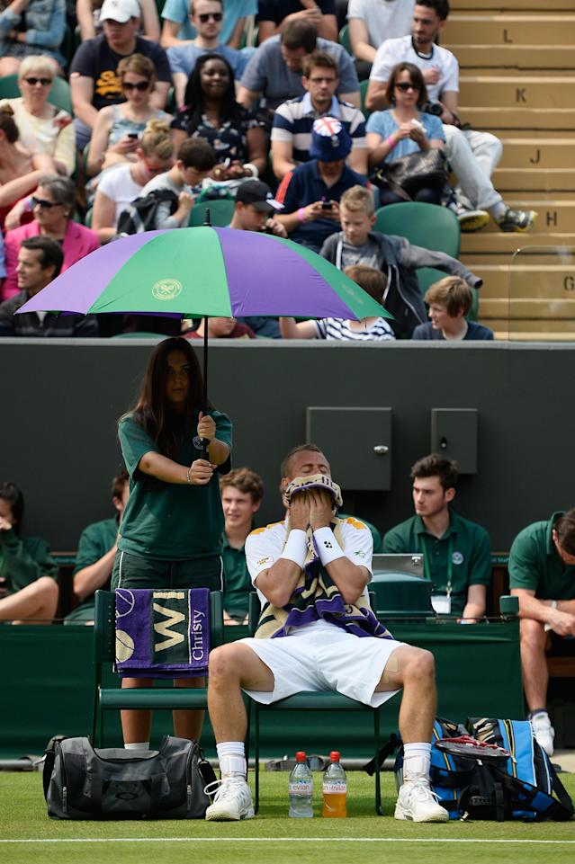 LONDON, ENGLAND - JUNE 26: Lleyton Hewitt of Australia wipes his face with a towel during a break in his Gentlemen's Singles second round match against Dustin Brown of Germany on day three of the Wimbledon Lawn Tennis Championships at the All England Lawn Tennis and Croquet Club on June 26, 2013 in London, England. (Photo by Dennis Grombkowski/Getty Images)