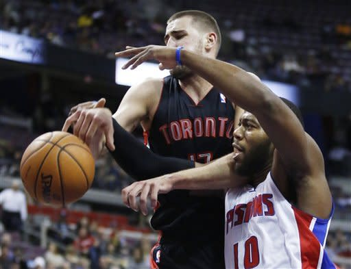 Detroit Pistons center Greg Monroe (10) is fouled by Toronto Raptors center Jonas Valanciunas (17) while chasing a rebound in the first half of an NBA basketball game, Friday, Nov. 23, 2012, in Auburn Hills, Mich. (AP Photo/Duane Burleson)
