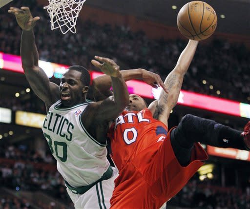 Atlanta Hawks' Jeff Teague (0) fouls Boston Celtics' Brandon Bass (30) during the first quarter of Game 4 of an NBA first-round playoff basketball series, in Boston on Sunday, May 6, 2012. (AP Photo/Michael Dwyer)