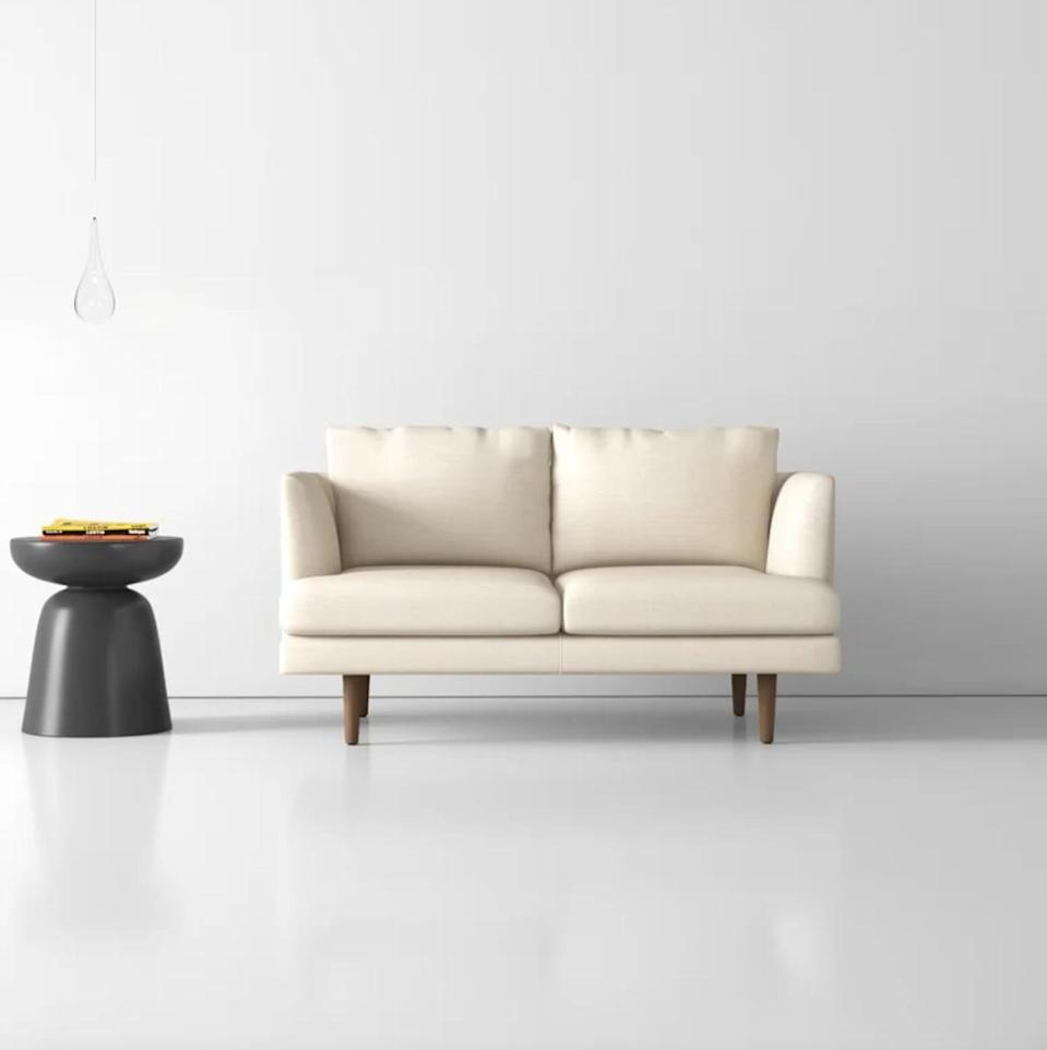 <p>You can't go wrong with the <span>AllModern Wide Recessed Arm Loveseat</span> ($700).</p>