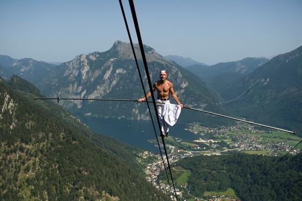 Getting high! Stuntman scales 10,000ft mountain - on cable car wires