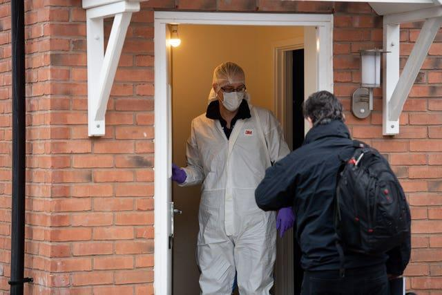 Forensics arrive at the property