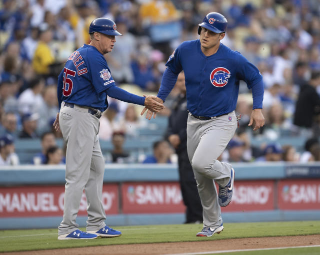 Chicago Cubs' Anthony Rizzo, right, celebrates his two-run home run with third base coach Brian Butterfield during the first inning of a baseball game against the Los Angeles Dodgers in Los Angeles, Friday, June 14, 2019. (AP Photo/Kyusung Gong)