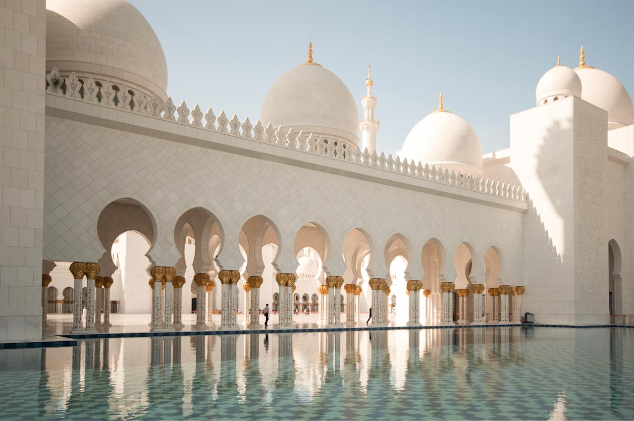 <p><strong>What's this place all about?</strong> Sheikh Zayed Grand Mosque, one of the world's largest, is an Abu Dhabi must-see. Completed in 2007, it can fit 40,000 visitors and worshippers into a space the size of four football fields. But it's not only the size that's impressive. The architecture is a shining culmination of cross-cultural influences. The architects were Emirati, Italian, and British, bringing together design elements from Turkey, Morocco, Pakistan, Egypt, and beyond.</p> <p><strong>How do you feel being there?</strong> The dominating mood is awe: This is a place that's impossible not to love, from the reflective pools to the towering onion-top domes. Inside, 82 white marble domes, 1,096 exterior columns, and a 24-carat gold Swarovski crystal chandeliers create a transcendental experience.</p> <p><strong>Is there a guide involved?</strong> Visitors can explore limited parts of the mosque on their own or with a private guide, though some areas remain open only to worshippers. For a deeper experience, free daily tours cover art and architecture, as well as their history and religious significance. Audio guides are also available at the entrance.</p> <p><strong>Who comes here?</strong> This is one of the most popular mosques in the world, drawing visitors from every corner of the globe. Expect to be surrounded by a melting pot of cultures, countries, and religious beliefs.</p> <p><strong>How much time should we plan to spend?</strong> Give yourself at least three hours to take in the beauty of this site.</p> <p><strong>So, then, what, or who, do you think it's best for?</strong> Anyone with an affinity for architecture, culture, design, and history will love this mosque.</p>