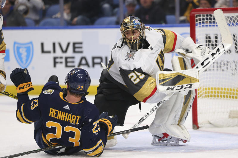 Buffalo Sabres Forward Sam Reinhart (23) and Vegas Golden Knights Goalie Marc-Andre Fleury (29) collide during the first period of an NHL hockey game Tuesday, Jan. 14, 2020, in Buffalo, N.Y. (AP Photo/Jeffrey T. Barnes)