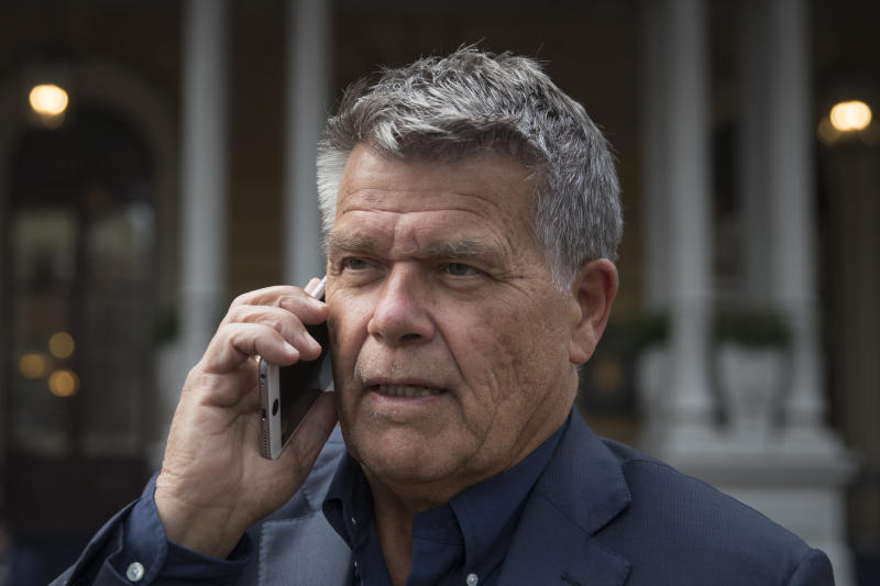 Self-styled Dutch positivity guru Emile Ratelband answers questions on his mobile phone during an interview in Amsterdam, Netherlands, Monday, Dec. 3, 2018. A Dutch court has rejected the request of a self-styled positivity guru to shave 20 years off his age, in a case that drew worldwide attention. Emile Ratelband last month asked the court in Arnhem to formally change his date of birth to make him 49, instead of his real age of 69. He argued his request was consistent with other personal transformations, such as the ability to change one's name or gender. The Dutch court said age matters under Dutch law. (AP Photo/Peter Dejong)