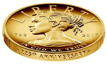 The new $100 gold coin featuring an African-American woman as the face of Lady Liberty for the first time in the history of U.S. currency, is shown in this photo in Washington, D.C., provided January 13, 2017.  Courtesy of The United States Mint/Handout via REUTERS