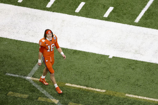 Clemson quarterback Trevor Lawrence leaves the field after their loss against Ohio State during the Sugar Bowl NCAA college football game Saturday, Jan. 2, 2021, in New Orleans. Ohio State won 49-28. (AP Photo/Butch Dill)