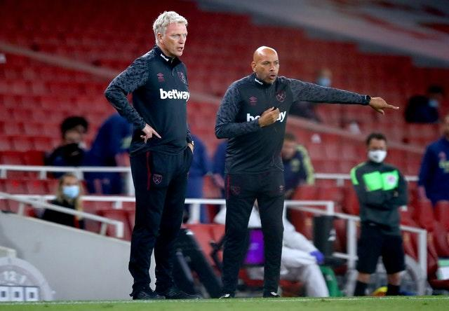 West Ham manager David Moyes, left, rued his side's missed chances at Arsenal