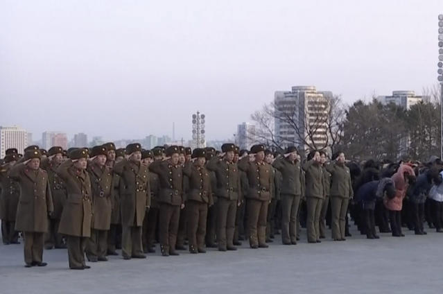 In this image taken from video footage, North Korean military personnel salute as they lay flowers in front of giant statues of Kim Il Sung and Kim Jong Il on Mansu Hill in central Pyongyang, Thursday, Feb. 8, 2018. (AP)