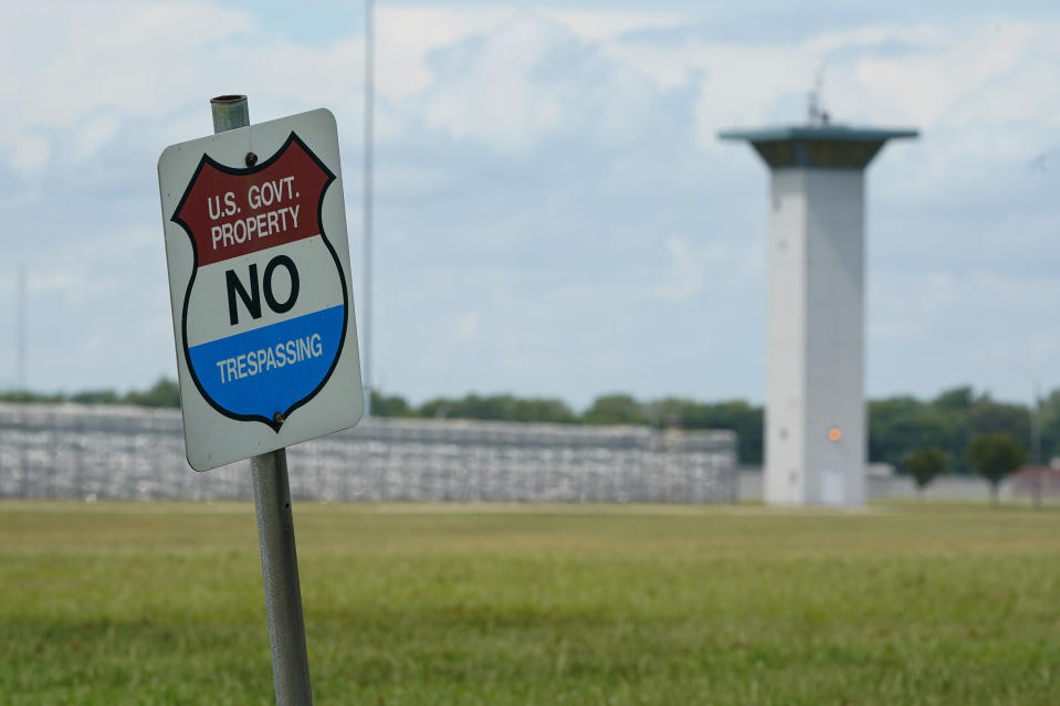 FILE - In this Aug. 28, 2020, file photo, a no trespassing sign is displayed outside the federal prison complex in Terre Haute, Ind. Over the past 18 months, 29 prisoners have escaped from federal lockups across the U.S. - and nearly half still have not been caught. (AP Photo/Michael Conroy, File)
