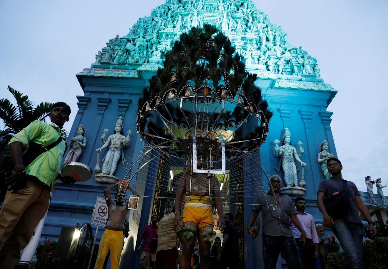 <p>Devotees leave a temple in their kavadis during the Hindu festival of Thaipusam in Singapore on 9 February 2017. (PHOTO REUTERS/Edgar Su) </p>