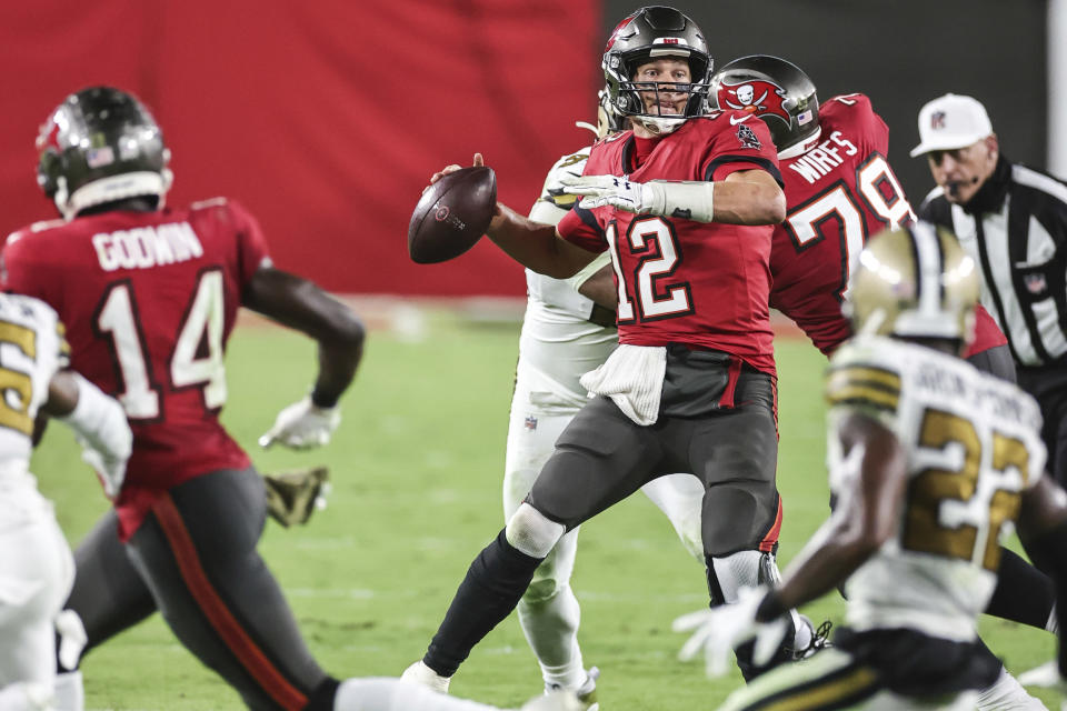Tampa Bay Buccaneers quarterback Tom Brady (12) looks for a receiver during an NFL game against the New Orleans Saints, Sunday, Nov. 8, 2020 in Tampa, Fla. The Saints defeated the Buccaneers 38-3. (Margaret Bowles via AP)