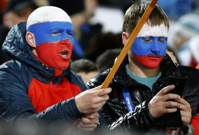 Russian fans cheer as they attend the men's ski jumping normal hill individual final event of the Sochi 2014 Winter Olympic Games, at the RusSki Gorki Ski Jumping Center in Rosa Khutor, February 9, 2014. REUTERS/Kai Pfaffenbach (RUSSIA - Tags: OLYMPICS SPORT SKIING POLITICS)