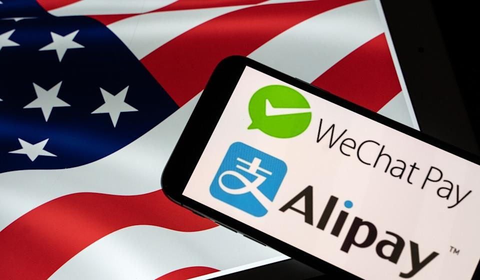 The logos of Tencent's WeChat Pay and Alibaba affiliate Ant Group's Alipay. US officials are considering a ban on investments in Tencent and Alibaba. Photo: Bloomberg