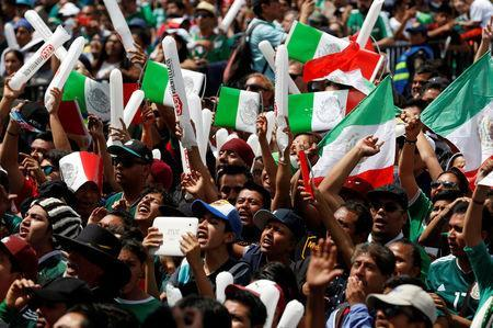 Soccer Football - FIFA World Cup - Group F - Germany v Mexico - Mexico City, Mexico - June 17, 2018 - Mexican fans celebrate at the Zocalo square. REUTERS/Gustavo Graf