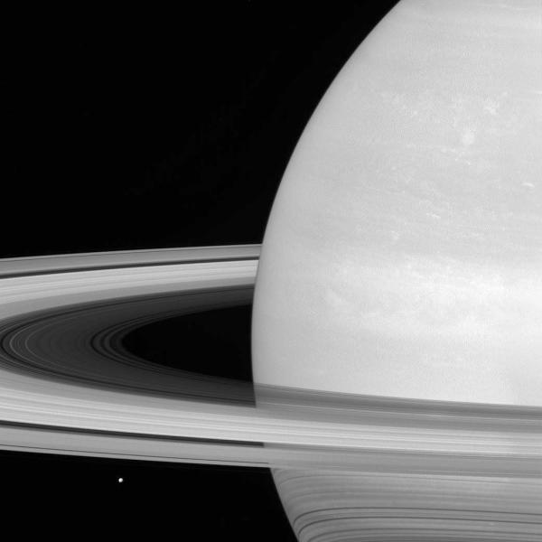 This undated photo made available by NASA shows one of Saturn's moons, Mimas, dwarfed by the planet's rings. Launched in 1997, Cassini reached Saturn in 2004 and has been exploring it from orbit ever since. Cassini's fuel tank is almost empty, so NASA has opted for a risky, but science-rich grand finale. (NASA/JPL-Caltech/Space Science Institute via AP)