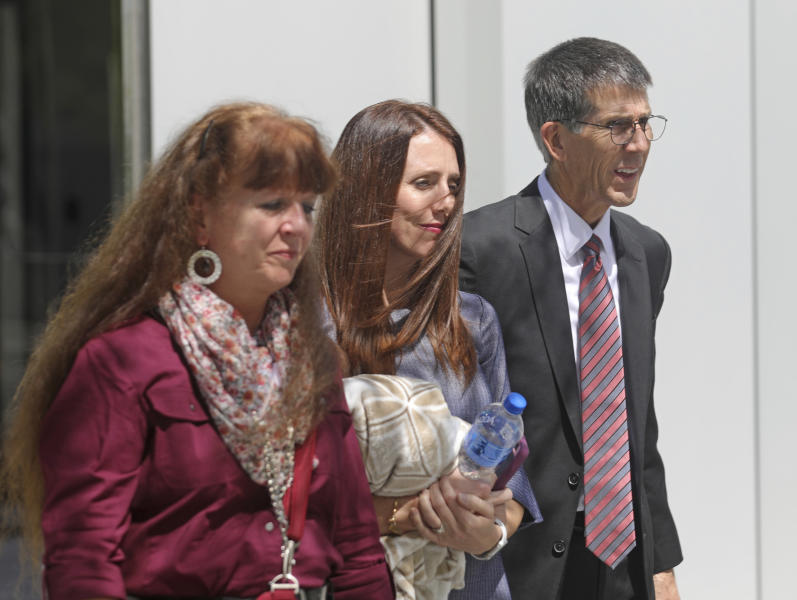 Mike, right, and Becky Shamo, left, the parents of Aaron Shamo, walk with another family member as they leave the federal courthouse Thursday, Aug. 29, 2019, Salt Lake City. A jury is deliberating in the case of a Utah man accused of running a multimillion-dollar opioid ring that shipped fake prescription drugs across the country, causing at least one fatal overdose. Prosecutors said during closing arguments that Aaron Shamo's operation helped fuel the nation's opioid epidemic by making hundreds of thousands of pills available to addicts and other users. (AP Photo/Rick Bowmer)