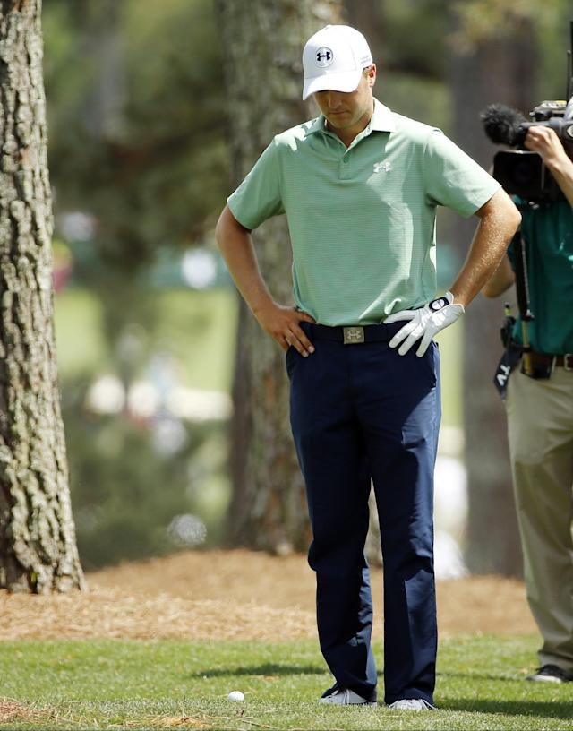 Jordan Spieth looks at his ball in the rough off the first fairway during the fourth round of the Masters golf tournament Sunday, April 13, 2014, in Augusta, Ga. (AP Photo/David J. Phillip)