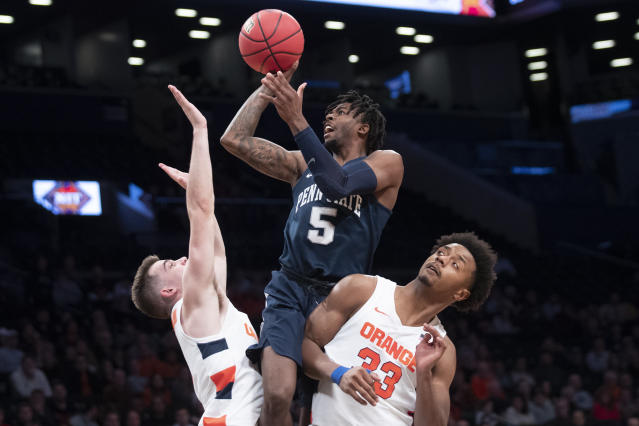 Penn State guard Jamari Wheeler (5) shoots as Syracuse forward Elijah Hughes (33) and guard Joseph Girard III defend during the second half of an NCAA college basketball game in the consolation round of the NIT Season Tip-Off tournament, Friday, Nov. 29, 2019, in New York. Penn State won 85-64. (AP Photo/Mary Altaffer)