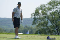Brooks Koepka looks on while working out on the driving range ahead of the BMW Championship golf tournament, Tuesday, Aug. 24, 2021, at Caves Valley Golf Club in Owings Mills, Md. The tournament begins Thursday. (AP Photo/Julio Cortez)