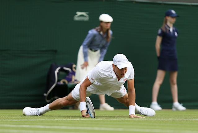 Czech Republic's Tomas Berdych slips in his match against Slovakia's Martin Klizan during day Two of the Wimbledon Championships at The All England Lawn Tennis and Croquet Club, Wimbledon.