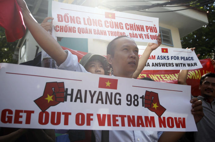 Vietnamese protesters hold banners during a protest rally against China outside the Chinese Consulate in Ho Chi Minh City, Vietnam, Saturday, May 10, 2014. Around 100 people gathered and protested China's deployment of an oil rig in the disputed South China Sea, in the country's commercial capital. Vietnamese anger toward China is running at its highest level in years after Beijing deployed the oil rig in the disputed water. (AP Photo)