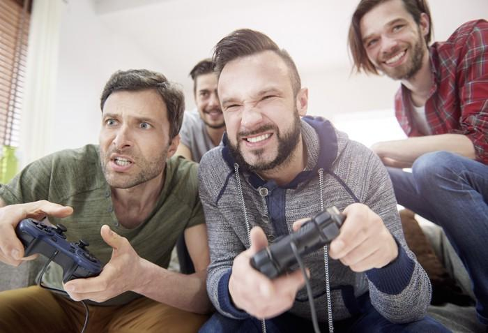 Young men playing video games.