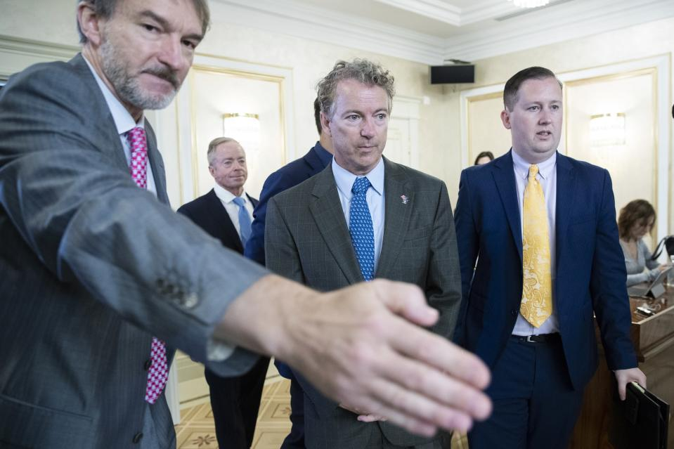 Sen. Rand Paul, center, and his communications director Sergio Gor, right, enter a hall during their meeting with Russian lawmakers in Moscow, Russia, Monday, Aug. 6, 2018. Paul said he invited Russian lawmakers to visit the United States to help foster inter-parliamentary contacts. (AP Photo/Pavel Golovkin)