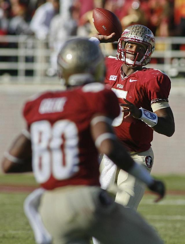 Florida State quarterback Jameis Winston (5) throws a pass to wide receiver Rashad Greene (80) in the second quarter of an NCAA college football game against North Carolina State, Saturday, Oct. 26, 2013, in Tallahassee, Fla. (AP Photo/Phil Sears)