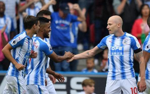 """Few winning goals in this Premier League season will be greeted with such unbridled joy as Aaron Mooy's 50th-minute strike but, when a club has waited 16,703 days for a home top-flight victory, such a response is understandable. November 27, 1971, and a 2-1 win over that season's champions Derby County, marked the last time that Huddersfield had won in front of their own supporters in the top tier. One of that day's goalscorers, the old entertainer himself, Frank Worthington, would have appreciated Mooy's finish as he watched on from the directors' box. The Australian, signed permanently this summer for £8 million after a successful loan spell from Manchester City, darted forward, exchanging passes with striker Elias Kachunga. As the Newcastle defence failed to cover his continued progress Mooy had enough space to get off a superb finish which curled into the far corner of Rob Elliot's goal. Aaron Mooy opens the scoring Credit: GETTY IMAGES And that was enough for David Wagner's side to record a second successive win to start their season, becoming just the third newly- promoted team in Premier League history to do so, following Bolton in 2001-02 and Hull last season. """"You don't have to pinch me but I didn't expect it either,"""" said Wagner. """"But it is football. If anyone knows that in football everything is possible, then it is here in our club, after what we've seen last season and after what we felt last season. """"We only wanted to be brave in every single game and search for our chance and I think we have done it so far. """"Obviously we are over moon with six points and two clean sheets and those points were deserved. This is what makes it for me an even bigger six points. """"This was a proper Premier League atmosphere. I asked for something extraordinary and the fans delivered. """"Even when we arrived on the coach, it felt different. With the supporters, it felt like the play-offs. I had no idea how the players would react but I was more relaxed after the experience aga"""