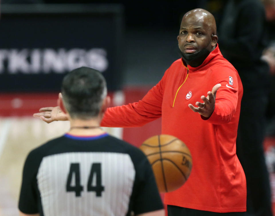 Atlanta Hawks head coach Nate McMillan, right, argues with referee Brett Nansel, left, during the second quarter of an NBA basketball game against the Detroit Pistons Monday, April 26, 2021, in Detroit. (AP Photo/Duane Burleson)