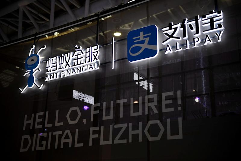 A logo of Ant Financial Services Group is seen next to a logo of Alipay at the Digital China Exhibition in Fuzhou, Fujian province, China May 5, 2019. Picture taken May 5, 2019. REUTERS/Stringer ATTENTION EDITORS - THIS IMAGE WAS PROVIDED BY A THIRD PARTY. CHINA OUT.