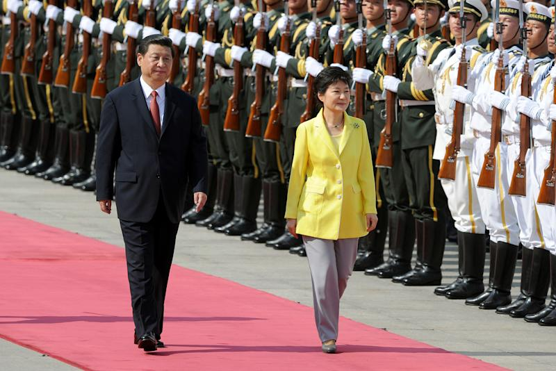 South Korean President Park Geun-hye, right, and Chinese President Xi Jinping inspect an honor guard during a welcome ceremony outside the Great Hall of the People in Beijing on Thursday, June 27, 20123. The Chinese and South Korean presidents reaffirmed close ties between their nations Thursday at a Beijing summit that brings together North Korea's archrival and its biggest ally, ratcheting up pressure on Pyongyang to rejoin nuclear disarmament talks. (AP Photo/Wang Zhao, Pool)