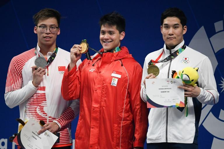 Singapore's Joseph Schooling broke the stranglehold of China and Japan, who had hitherto won every gold medal on offer, by retaining his Asian crown in the 100 metres butterfly