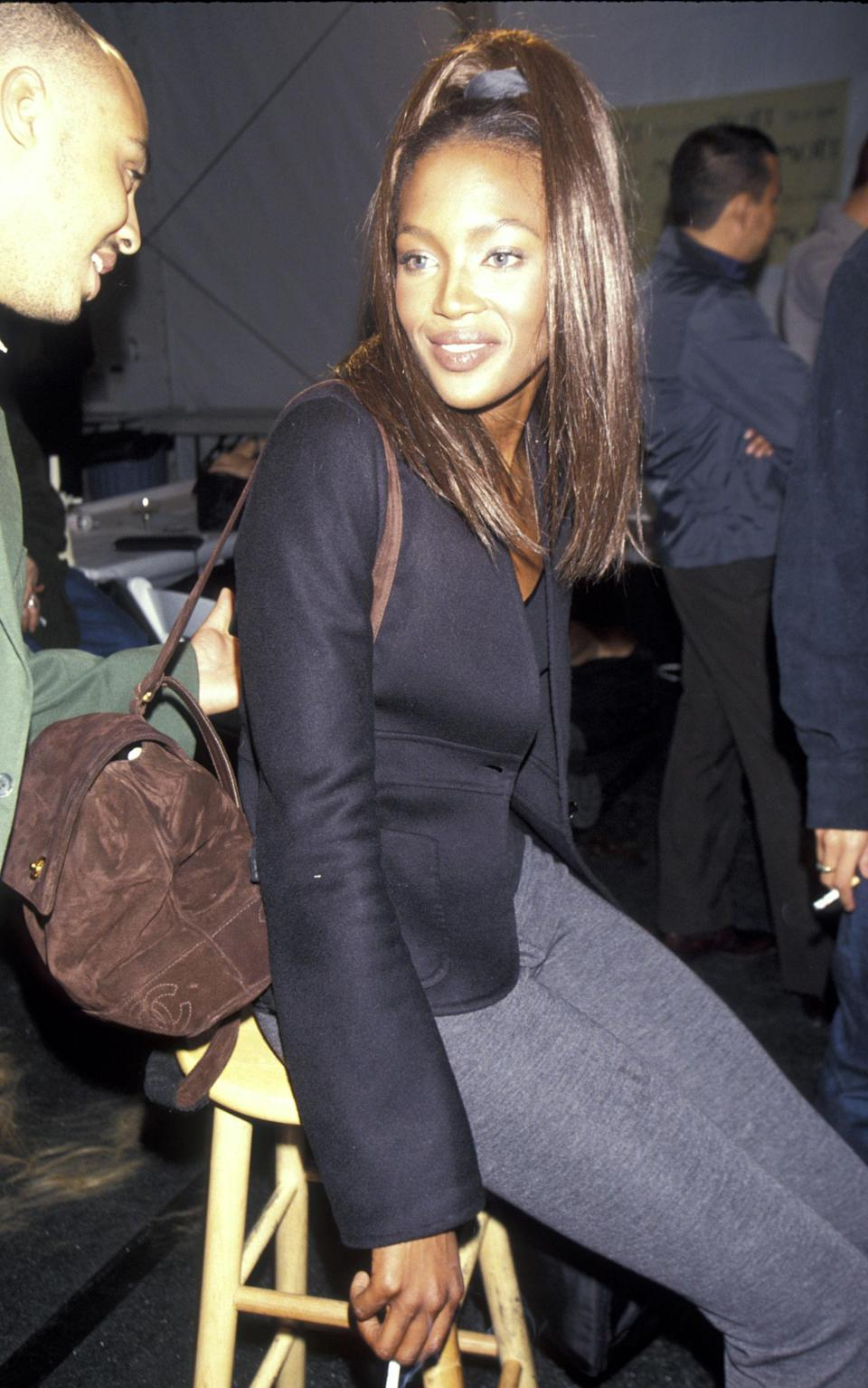 <p>Naomi Campbell sports a blazer and backpack at the Todd Oldham Fashion Show, 1996</p>