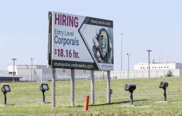 Image: A billboard advertises the availability of jobs with the Nebraska Department of Correctional Services in 2018 (Nati Harnik / AP)