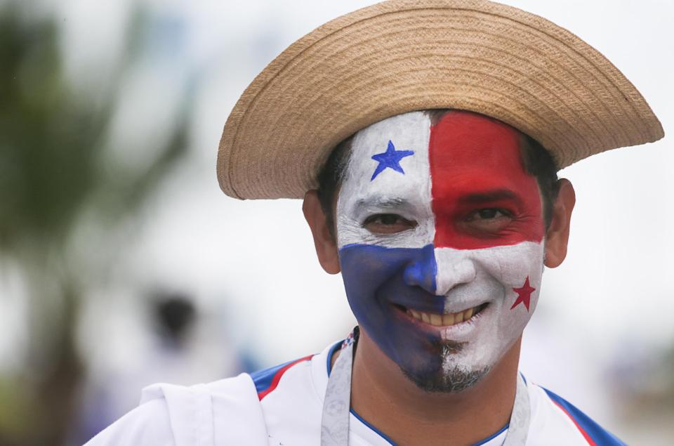 <p>A Panamanian football fan proudly displays the white, blue and red of the World Cup debutants. (Getty) </p>